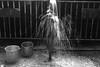 Street bath(explored) (Rajib Singha) Tags: travel street city dailylife outdoor water interestingness flickriver canoneos40d kolkata westbengal india