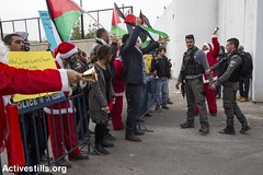 Protest against the occupation, Bethlehem, West Bank, 23.12.2016 (Activestills) Tags: bethlehem demonstration westbank palestine soldiers israeliarmy checkpoint300 separationwall palestinianpopularstruggle christmas occupation borderpolice flag topimages kerenmanor