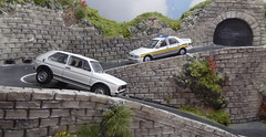 Delta Six Nine Persuing Golf GTi Hairpin Pass. (ManOfYorkshire) Tags: vw volkswagen golf gti golfgti sierra sapphire police patrol car bluelight chase chasing hairpin pass road 176 scale model cars auto automobiles oogauge oxforddiecast