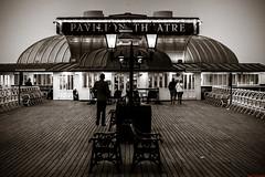 Pavillion Theatre (aljones27) Tags: people blackandwhite bw monochrome night dark walking person evening coast pier seaside walk norfolk tourist tourists coastal late cromer