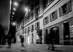The Out-Of-Towners (lothar1908) Tags: street windows people bw italy night canon walking lights strada italia shadows gente milano ghosts luci notte fashiondistrict finestre sconosciuti viadellaspiga persiane fantasmi lungheesposizioni ef20mmf28usm canoneos5dmarkiii
