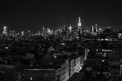 Never Sleeps (B&W version) (BrianEden) Tags: city nyc newyorkcity pink sky blackandwhite bw ny newyork skyline night lights us fuji unitedstates dusk manhattan soho fujifilm tribeca empirestatebuilding xpro1