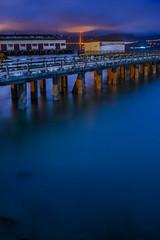 the unwanted pier (pbo31) Tags: sanfrancisco california bridge november blue urban color reflection water night bay pier nikon over 101 goldengatebridge bayarea fortmason aquaticpark 2015 boury pbo31 d810 maritimenationalhistoricpark