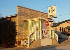 Croz Pub & Grub, Twin Lakes Wisconsin (Cragin Spring) Tags: wisconsin wi southernwisconsin midwest building architecture unitedstates usa unitedstatesofamerica smalltown twinlakes twinlakeswi twinlakeswisconsin bar tavern crozpubgrub croz sign flag sunset dusk