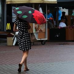 Colorful umbrella (Mikhail Korolkov) Tags: street streetphotography rain umbrella dress polkadot walk lady woman fujifilm xe1 xc50230 mcdonalds