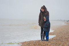 mother and son (jimmyafc) Tags: beach mum son stones dymchurch cold coat hat mother child fun happy uk kent sea