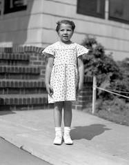 box of negatives0002.jpg (The Digital Shoebox) Tags: negatives monochrome girl outside dress people found snapshot ebay frontporch blackandwhite