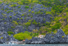 an island in bacuit bay,palawan,east philippine sea (larrygomez46) Tags: travel landscape islands philippines environment nationalparks elnido palawan limestonecliffs exoticplaces fineartsimages