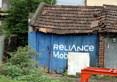 Reliance Mob (cowyeow) Tags: street city travel blue people india sign mobile asian town store funny asia phone indian shed mob smartphone crime covered shops maharashtra shack mobster funnysign telecoms southasia reliance funnyindia
