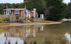 Empty at Present (Tones Corner) Tags: red reflection cottage bach coastal takaka tatabeach nzscene 60d canon60d