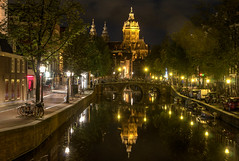 Amsterdam (jzakariya) Tags: bridge light red holland reflection building church netherlands beautiful amsterdam skyline architecture night river nikon europe long exposure god outdoor district prostitute reflected prostitution devil nikkor hdr jawad zakariya d300s