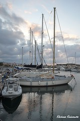 Marina at sunset (Eleanna Kounoupa) Tags: sunset sea sky water weather clouds port boats greece crete  rethymnon