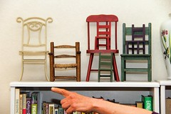 Not Here But There (David K. Edwards) Tags: hand chairs finger books vase pointing