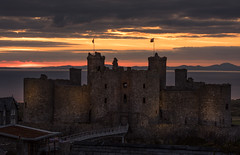 Harlech Castle Sunset (Mike Ashton) Tags: sunset sea castle wales coast flag medieval fortification castellations