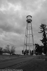 Water Tower (backerharrison132) Tags: old autumn trees winter sky blackandwhite cloud white storm black cold building tree tower fall nature water monochrome beautiful beauty field grass rain weather metal clouds danger america warning dark season landscape concrete outdoors grey design town big nikon mood angle natural serious cloudy outdoor ominous steel empty hurricane small perspective large structure mo dirt missouri land tall 1855 majestic tornado imposing majesty perryville d3300