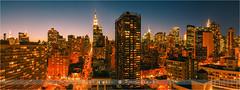 View over Manhattan - New York City (~ Floydian ~ ) Tags: new york city newyorkcity longexposure light sunset panorama usa skyline america canon photography lights evening twilight cityscape skyscrapers unitedstates stitch dusk manhattan pano panoramic le stitching bluehour wideview floydian canoneos1dsmarkiii henkmeijer