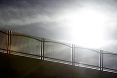 IMG_8534 (Paul L Dineen) Tags: road bridge light sun white abstract fence dark gate bright overpass artsy minimalism enchanted eyebeholderjan2016cut2 eyebeholderjan2016