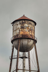 Water Tower with Characgter (Erin Cadigan Photography) Tags: purple water tower metal old rustic arcangel