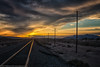 Mojave Sunset (dejavue.us) Tags: railcrossing california nikon desert d800 clouds yermo mojavedesert gold nikkor yellow sunset railroad