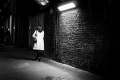 Away From The Spotlight (Cliff.j) Tags: lady walking night heels coat handbag light brick detail london southwark bridge street dark block paving sony a7 carl zeiss sonnar 55mm