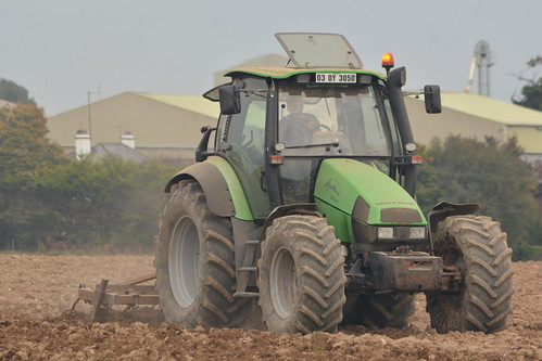 Deutz Fahr 135 Mk3 Tractor with a Tine Harrow