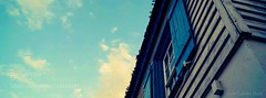 Lone Window (PhoenixRoofing164) Tags: sky city downtown travel blue clouds cloudy tourism urban architecture roof beautiful scene culture cloud facade colorful reflect exterior roofing perspective colors window europe warm vibrant mystical springtime lone