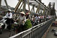 Woman riding a bicycle and many other people riding scooters on Long Bin bridge during rush hour in Hanoi - Vietnam (PascalBo) Tags: street bridge people woman hat bike bicycle outdoors nikon asia southeastasia vietnamese outdoor femme capital scooter vietnam motorbike cycle chapeau moto motorcycle pont vehicle asie capitale hanoi rue bicyclette vlo conical d300 vitnam hano vitnam hni conique asiedusudest culongbin longbin longbinbridge pascalboegli pontlongbin