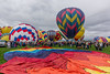 Balloon spread on ground and balloons launching (Vironevaeh) Tags: sky cloud newmexico balloons us unitedstates cloudy aviation balloon albuquerque hotairballoon balloonfiesta hotairballoons albuquerqueballoonfiesta albuquerqueinternationalballoonfiesta sonyalpha850