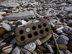 stone in brick ((robcee)) Tags: toronto ontario canada beach stone rust rocks steel bricks rebar geolocation 2015 tommythompsonpark geo:state=ontario geo:country=canada geo:city=toronto camera:make=olympusimagingcorp exif:make=olympusimagingcorp exif:lens=lumixgvario714f40 exif:aperture=ƒ40 camera:model=em1 exif:model=em1 exif:isospeed=400 exif:focallength=7mm geo:lat=43626461111112 geo:lon=793233