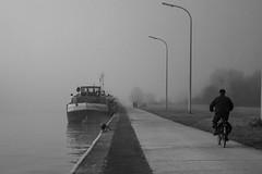 Pdaler au bord de l'eau (celinadayton) Tags: blackandwhite mist man nature water fog outside boat canal eau cyclist belgium belgique noiretblanc bateau paysage extrieur brouillard channel brume homme cycliste lige peniche herstal