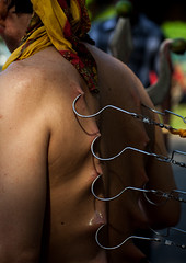 A Devotee Has His Back Pierced With Hooks During The Thaipusam Hindu Festival At Batu Caves, Southeast Asia, Kuala Lumpur, Malaysia (Eric Lafforgue) Tags: shirtless pierced people man men festival vertical religious outdoors photography pain asia southeastasia day skin indian faith religion ceremony piercing parade celebration event malaysia devotion pierce ritual strength kualalumpur spirituality hook tradition devotee endurance hindu hinduism malaysian bodypart cultures pilgrimage batu batucaves thaipusam hindi pilgrim oneperson selangor decorated mutilation penance 40sadult onemanonly 1people unrecognizableperson humanback kl433