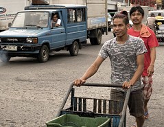 Pushing (Beegee49) Tags: street city man men market trolley philippines bacolod cart pushing