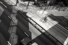 (David Davidoff) Tags: people street life shadow grid bridge cityrhythm urbanlandscape geometry analogue human blalckwhite leicam6 rangefinder delivery bikebicycle above aerialview moment