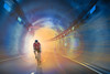 Tunnel Rider (psmithusa) Tags: cyclist rider tunnel light lighting effects sun flare red blue gold yellow athlete composite