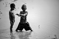 What is this? (-clicking-) Tags: streetphotography streetlife life dailylife children childhood childish childlike country countrylife nocolors blackandwhite blackwhite monochrome monotone bw vietnam innocence innocent