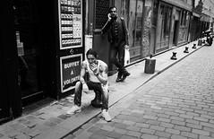 Buffet à volonté (Paolo Pizzimenti) Tags: homme cigarette tableau vitrine verre lappe rue paris paolo olympus zuiko penf 12mm 17mm f2 f18 m43 mirrorless film pellicule argentique doisneau