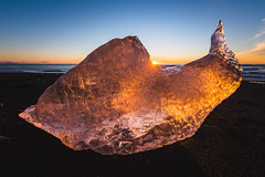 """A"" chunk of ice (modesrodriguez) Tags: 2016 iceland islandia landscape paisaje travel viaje sunset sunstar orange yellow sunrise sun ice iceberg beach blacksand"