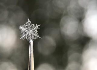 Snowflake on metal