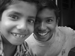 Curious (Offthebeatentrack) Tags: portraits blackwhite faces smiles sri lanka childrenofsrilankabw