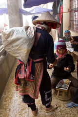 Marketplace shopping (Kalabird) Tags: travel vacation asia market embroidery vietnam clothes sapa hilltribes reddzao canonef24105mmf4lisusm sapamarket