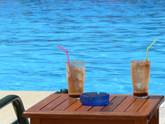 Soooo refreshing! (Lazy B) Tags: blue caf pool marina swimming table glasses may stainedglass 2006 greece ashtray fz5 corfu lounger straws frapp kerkira gouvia