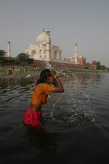 A Lady Beating the Heat of Summer at Yamuna River, Behind Taj (Captain Suresh Sharma) Tags: travel red woman india holiday heritage water festival architecture lady river hair fun bath asia faith religion tomb ceremony culture taj unescoworldheritagesite dome ritual splash waterdroplets buidling routine beatingheat holydip hinduritual pollutedyamunariver captsureshsharma dussehrafestival splashinriveryamuna religiousritualsbyindians pollutioninyamuna dusehra dusherafestival imagesofindianfestivals photosofindianfestivals ladysplashingwater touristdestinationsofindia imagesofindianmonuments