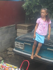 vantage point (birdfarm) Tags: red people food green girl car gum stand chair child candy gente curls skirt vendor nicaragua managua sell selling seller taillights nicaraguënse