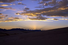 Sunset over the mountains (Codejoy) Tags: sunset shadow sky mountain newmexico reflection sand whitesands dunes flickrimportr picasa shade nm sunbeams port4