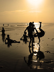 At Play - Second Edition (Life in AsiaNZ) Tags: china light people sun sunlight playing men beach water silhouette backlight canon asia play accepted1of100 been1of100 chinese powershot    beihai  guangxi         25faves   lifeinnanning flickrgiants