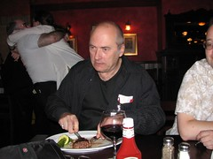 John Clute finishes Pam Zoline's dinner; people kissing in the background at Readercon