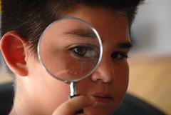 Under Investigation (fotoJENica) Tags: eye child play magnifyingglass juego nino lupa jugando detective magnification investigacion