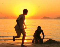 Golden boy take your place in the Sun (neloqua) Tags: ocean light boy sunset sea summer brazil sun sunlight beach southamerica water beautiful riodejaneiro wonderful wonder fun happy golden daylight amazing fantastic sand perfect colorful action great joy adorable sunny running excellent summertime moment lovely charming magical sunsetlight shining niteroi sunnyday