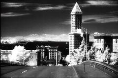 Smith Tower, Seattle (joshua_putnam) Tags: seattle water landscape ir cityscape shoreline infrared wa pugetsound washingtonstate om1 saltwater smithtower seattlewa kingcountywa