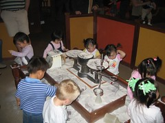 Chaos at the sand table (Discovery Museum)